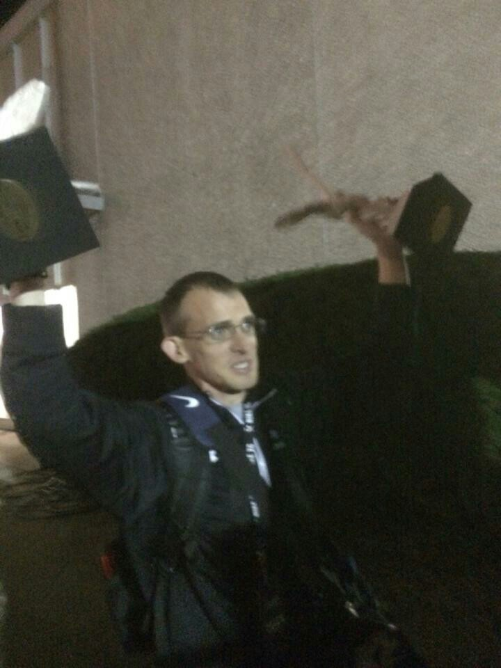 Coach Hedrick celebrates his team's success by hoisting the hardware.