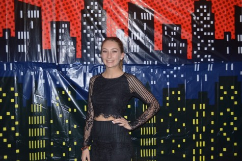 Maddy Parise dressed in black long sleeved separates with a lace overlay