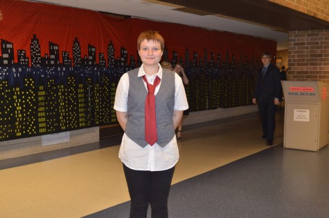 Kaitlin Kanthak dressed in a vest over a dress shirt and tie.