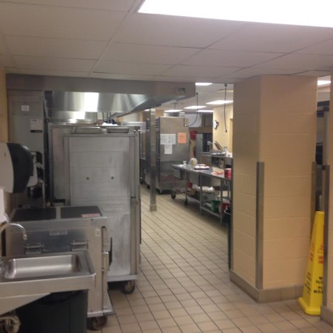 Behind where food is served to students